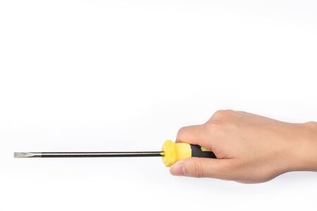 An Asian hand holds a screwdriver on a white background Stok Fotoğraf