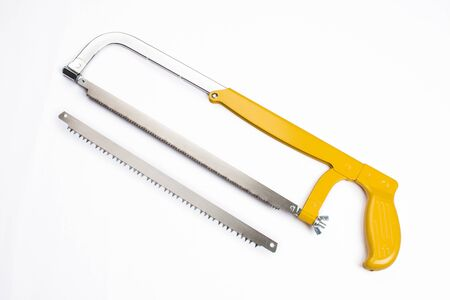 a yellow saw and a saw blade on a white background