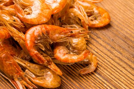 Pile of dried river prawns on a wooden table