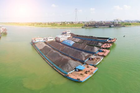 Aerial photography of a cargo ship parked on the river surface filled with coal