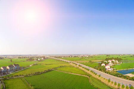 Aerial photography of a road bridge through green farmland Stok Fotoğraf