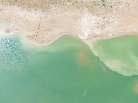 waterfront aerial picture, green river and  footprints of the river beach