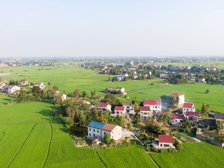 a small southern village surrounded by lush rice fields Stok Fotoğraf