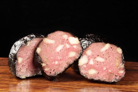 Pig blood tofu meatballs sliced on wooden board