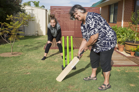 Grandmother having a turn at batting.