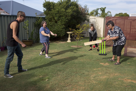 Traditional family game of cricket.