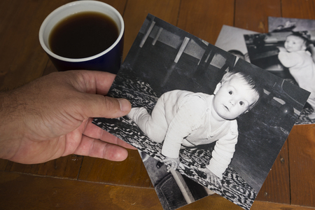 A man looking through old photos and remembering the past
