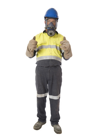A man wearing industrial protective equipment giving a thumbs up signal.