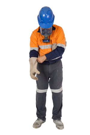 An industrial worker donning his personal protective equipment. Zdjęcie Seryjne