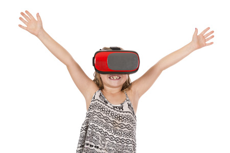 A girl amazed by virtual reality goggles.