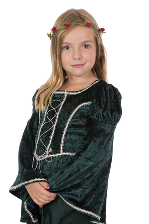 A girl dressed as a medieval princess posing for portrait.