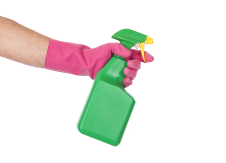 Close up of a hand using a spray bottle, against a white background.