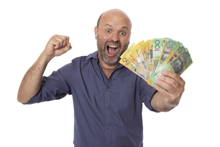 A happy Australian man holding a stash of cash.