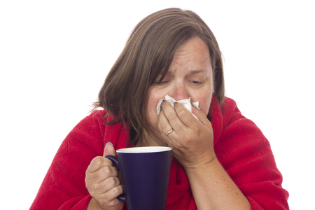A mature woman with a cold or flu.