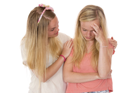 A female friend comforting a person who is sad, hurt or depressed.