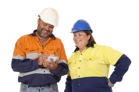 A male and female worker working as a  team and doing a risk analysis for safety.