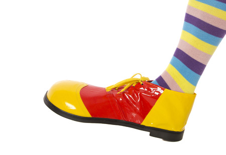 A colourful clown leg stepping into frame. Zdjęcie Seryjne