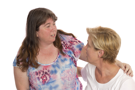 A caring woman consoling her friend and supporting her with her problems. Stock Photo