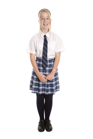 A full length image of a high school student standing with her face to the camera.