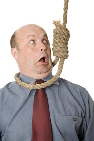 A businessman in noose, a cut backs, financial crisis concept.