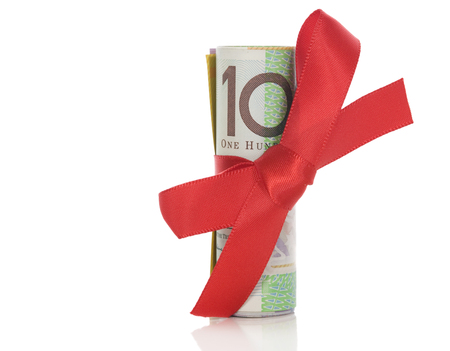 An Australian one hundred dollar note tied with a red bow.
