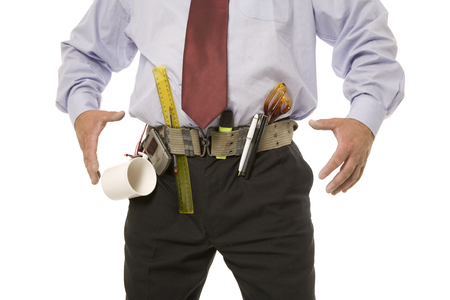 A man with a utility belt prepared for a day at the office.