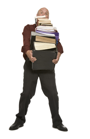 An office worker carrying a stack of files and books. Stock fotó