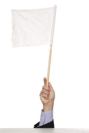 A hand holding a white flag of surrender.