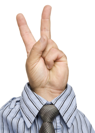 A hand giving a peace sign, wearing a shirt and tie.