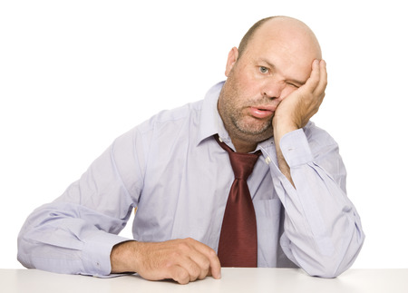 An office worker with a bored and exhausted appearance. Stock Photo