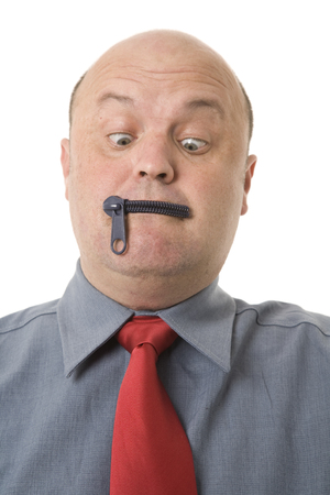 Zipped lips concepts, a man with a zipper over mouth.