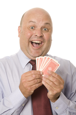A chance and luck business concept with a man holding plaing cards.
