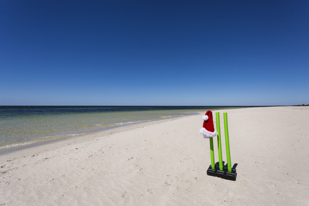 Cricket wickets on a beautiful Australian beach during the festive season. Stock Photo
