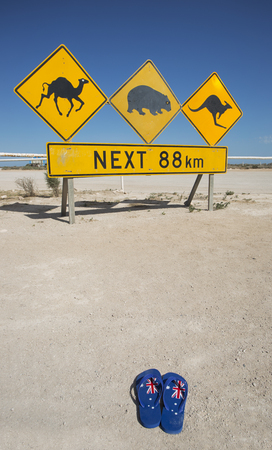 A pair of thongs and an iconic Australian road sign for Australia Day.
