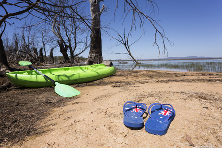 Australian themed thongs with a kayak in the background for Australia Day themes. 写真素材