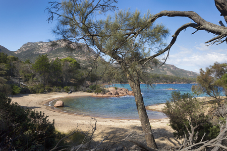 A stunning view of Honeymoon Bay and the Hazards at Freycinet National Park Tasmania.