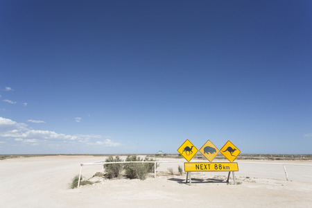 Animal warning signs on Australias treeless plain.