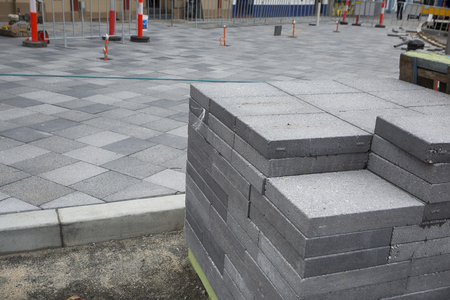 A pile of paving stones on an urban construction site.
