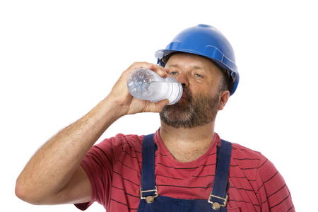 A worker drinking from a water bottle, a safety concept.
