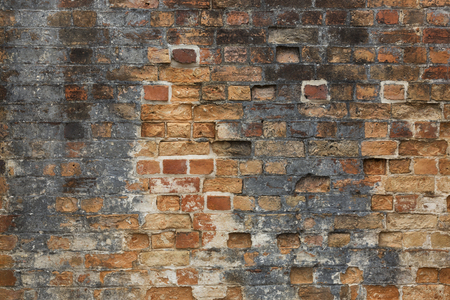 An old brick wall with interesting random pattern and rough texture.