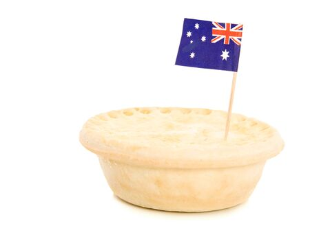 A beef pie with an Australian flag on white.