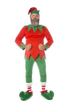 A Christmas Elf in an aggressive strong stance, possibly a security guard - fun concepts.