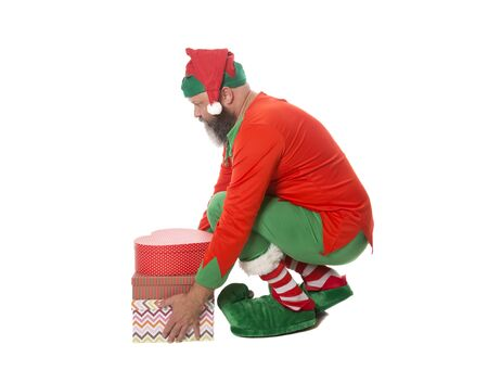 A Christmas Elf lifting gifts with a good lifting technique.
