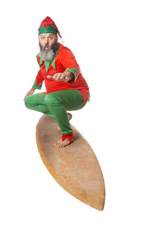 An Elf surfing, isolated on white.