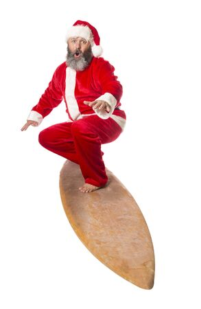 Santa surfing, isolated on a white background. Banco de Imagens