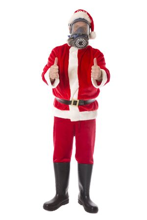 Santa wearing protective gear against coronavirus,thumbs up for a positive holiday.