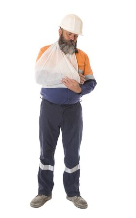 A full length image of an industrial worker injured in an accident with depressed expression, isolated on white.