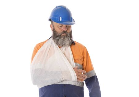 A Worker with an arm injury with a sad and worried expression.