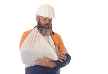 A Worker with an arm injury with a sad and worried expression. Banco de Imagens