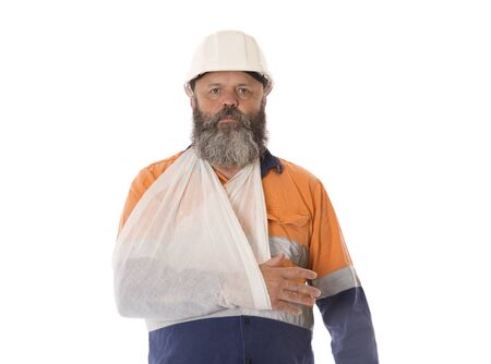 An industrial worker with arm in sling.